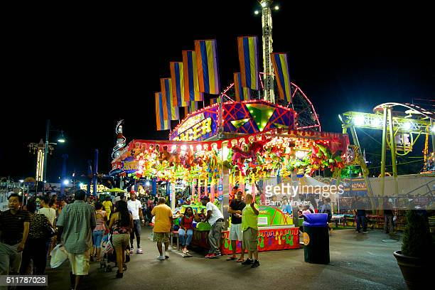 Night view of people enjoying Coney Island