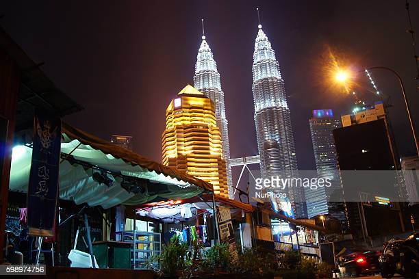 A night view of Petronas Twin towers in Kuala Lumpur City seen from Kampung Baru enclave Kuala Lumpur Malaysia on 23th March 2016