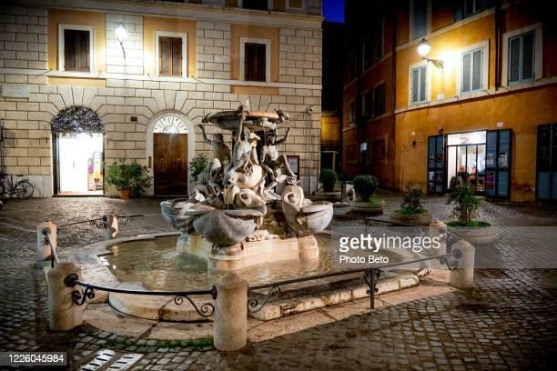 a night view of piazza mattei in the heart of the jewish ghetto of rome - roma città foto e immagini stock