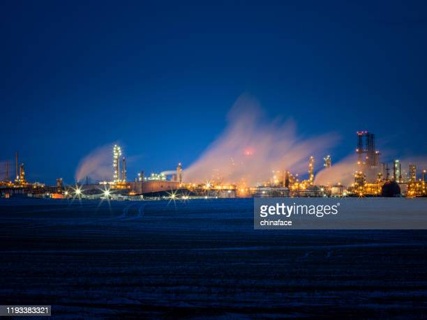 night view of refinery complex - regina saskatchewan stock pictures, royalty-free photos & images