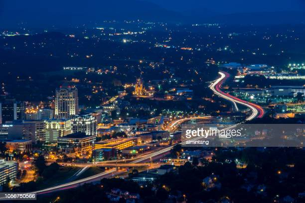 night view  of roanoke from mill mountain park - virginia stock pictures, royalty-free photos & images