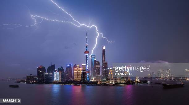 night view of Shanghai Lujiazui buildings with lightning
