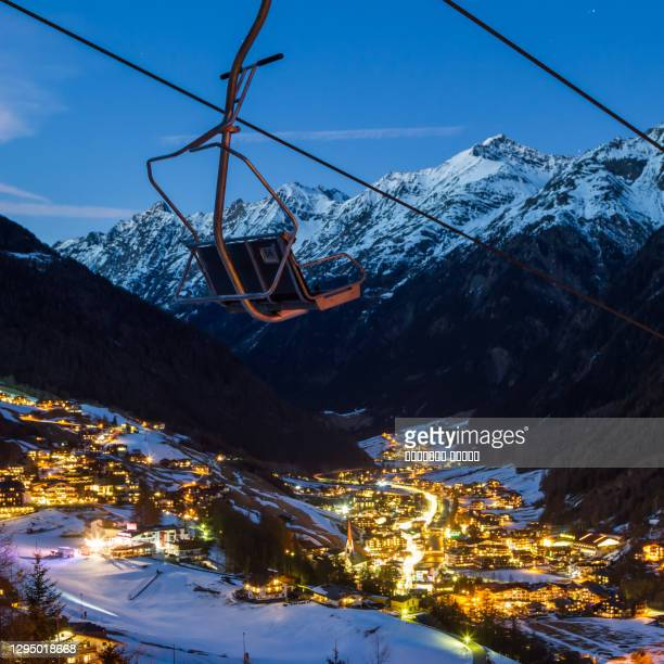 night view of solden ski resort in austria. with old chairlift in the foreground - solden stock pictures, royalty-free photos & images