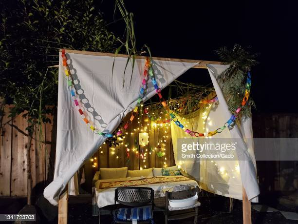 Night view of sukkah or ritual outdoor hut for the Jewish holiday of Sukkot, Lafayette, California, September 20, 2021.