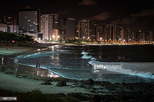 A night view of the beach in Fortaleza state of Ceara in northeastern Brazil on April 16 2013 AFP PHOTO/Yasuyoshi CHIBA