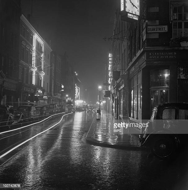 A night view of the corner of Dean Street Soho London August 1955