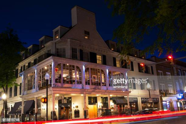 night view of the corner room on college avenue at state college - state college stock photos and pictures
