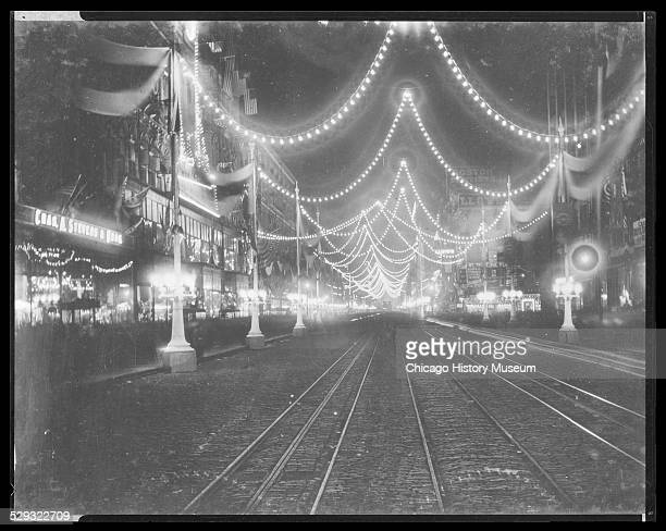 Night view of the dedication of the World's Columbian Exposition world's fair on State Street Chicago Illinois 1892