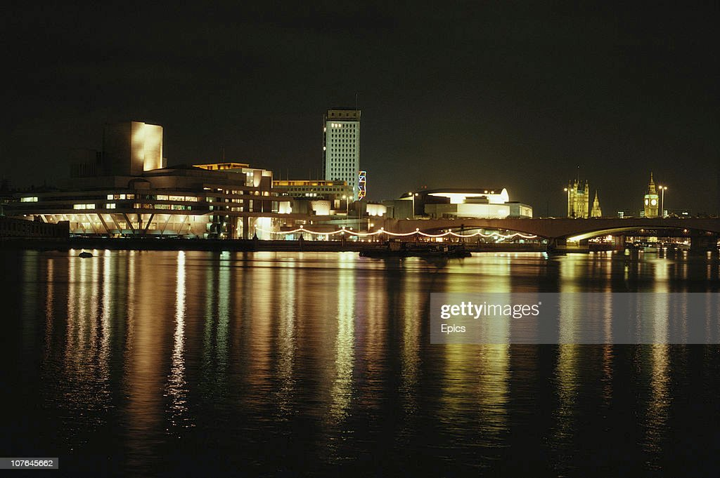 A night view of the illuminated South Bank theatre complex by the River Thames, London, March 1978.