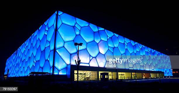 A night view of the National Aquatic Center known as the Water Cube as it is lit up on January 21 2008 in Beijing China The venue can hold 17000...