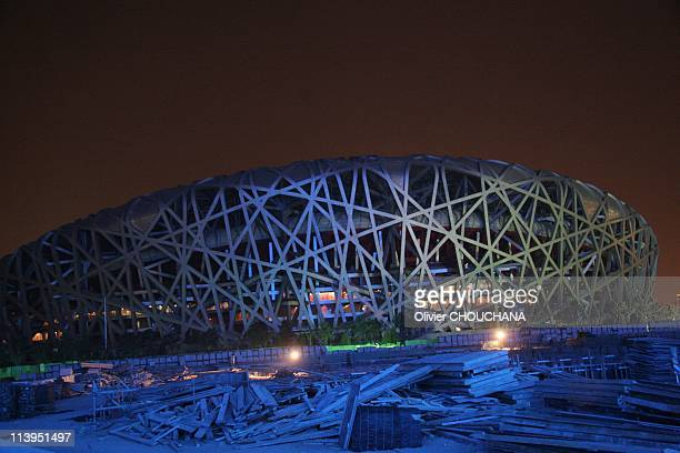 """Night view of the National Stadium for the 2008 Olympic Games, the """"Bird Nest"""" and """"Water Cube"""" in Beijing, China on January 26, 2008-Night view of..."""
