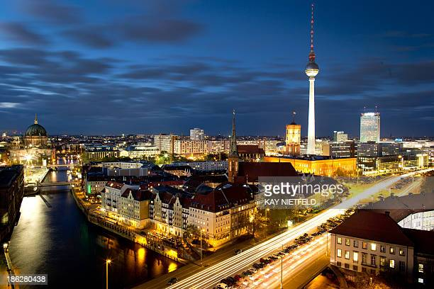 A night view of the Nicholas Quarter with the 800year old church City Hall and the Television Tower in Berlin Germany on October 29 2013 AFP PHOTO /...