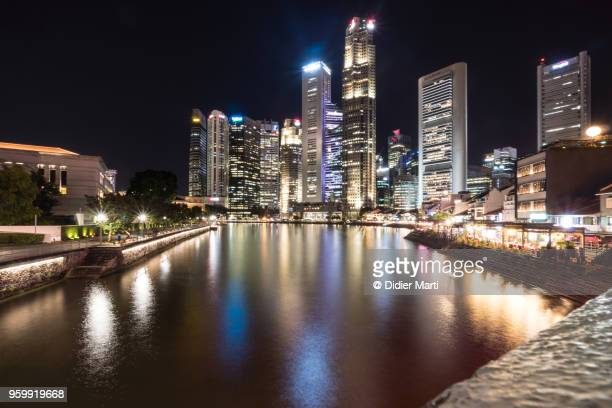 Night view of the Singapore river along Clark Quay in Singapore downtown district