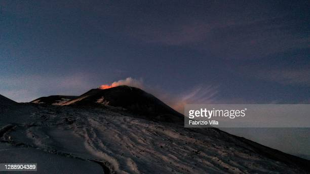 Night view of the Strombolian activity of the summit craters of the volcano Etna, photographed from an altitude of 2900 metres, with explosions and...