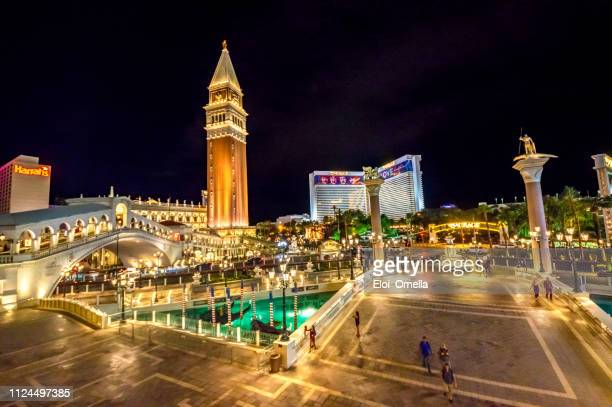 night view of the venetian mirage and harrah's hotels in las vegas, nevada - the mirage las vegas stock pictures, royalty-free photos & images