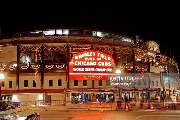 A night view of the Wrigley Field marquee celebrating the Chicago Cubs' world series win against the Cleveland Indians in Chicago Illinois on...