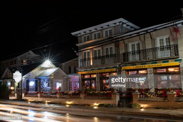 night view of timeout sports bar with people dining inside on route 73 in skippack township - montgomery county pennsylvania stock pictures, royalty-free photos & images