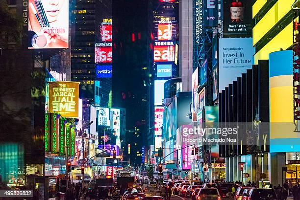 Night view of Times Square New York city Busy street with glowing signboards and billboards at night at the Times Square NYC The tourist landmark is...