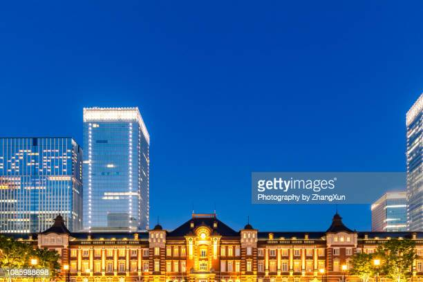 night view of tokyo station illuminated with blue sky, chiyoda ward, japan at summer. - tokyo station stock photos and pictures