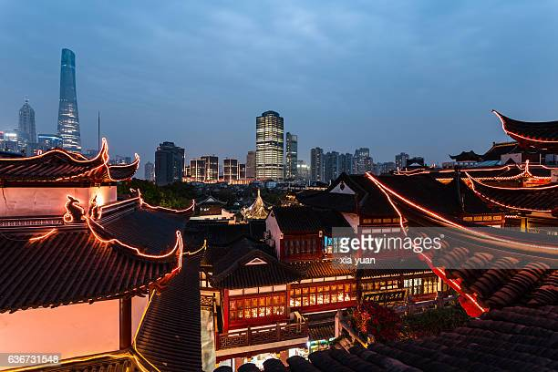 Night view of traditional chinese buildings against downtown skyline,Shanghai