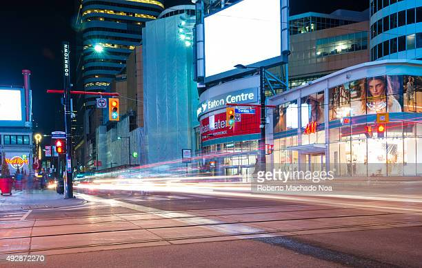 Night view of Urban Eatery at Eaton Center on the Dundas Street in Downtown Toronto The vehicular traffic leave trails of light Urban Eatery features...