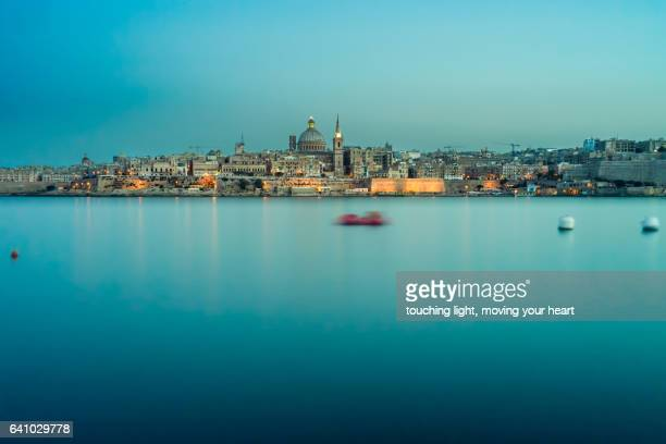 night view of valletta seafront skyline, malta - valletta stock pictures, royalty-free photos & images