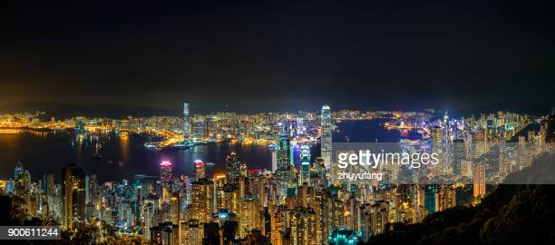 night view of victoria harbour - far east stock photos and pictures