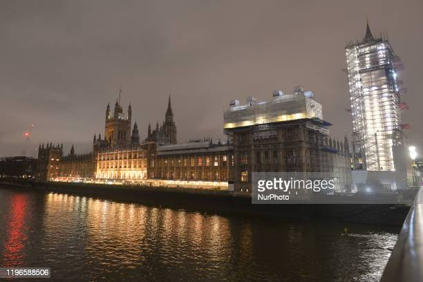 Night view of Westminster Palace and Big Ben covered in scaffolding during renovation work. On Wednesday, 22 January 2019, in London, United Kingdom.