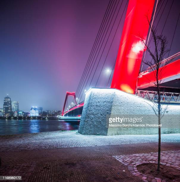 night view of willemsbrug (willem bridge) - image stock pictures, royalty-free photos & images