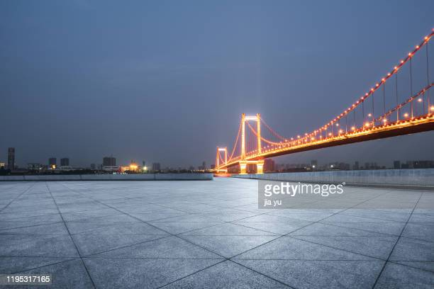 night view of wuhan yingwuzhou bridge. - wuhan stock pictures, royalty-free photos & images