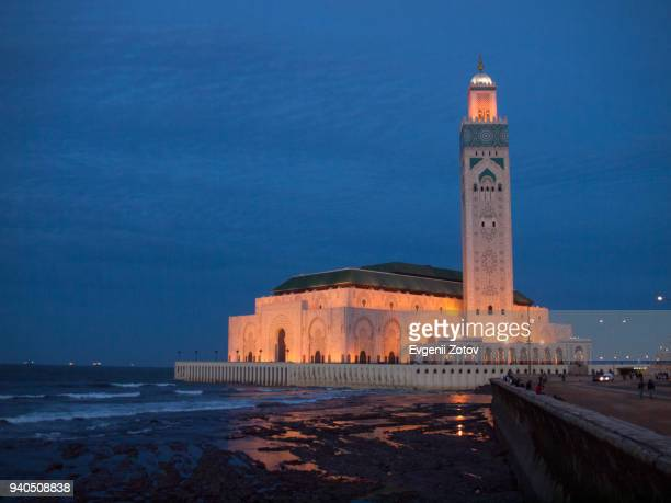 night view on hassan ii mosque in casablanca, morocco - mosque hassan ii stock photos and pictures