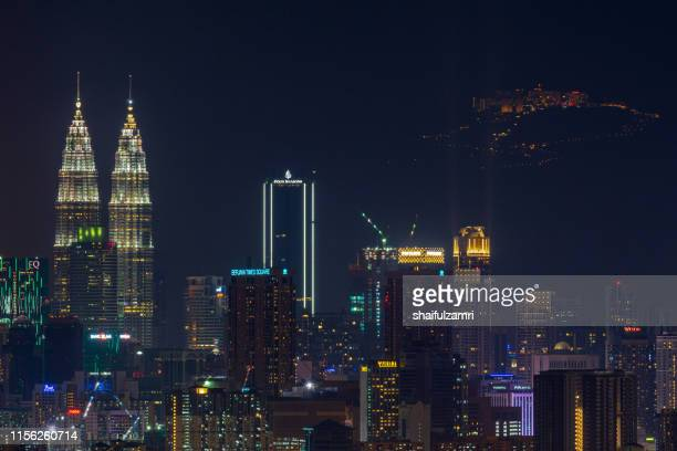 night view over downtown kuala lumpur with genting highlands seen as background. - shaifulzamri stock pictures, royalty-free photos & images