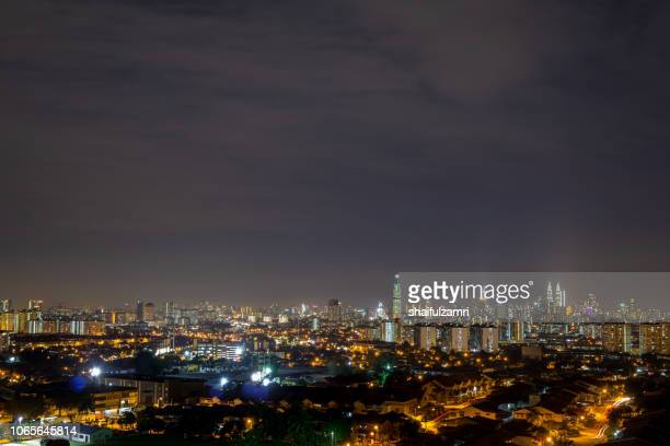 Night view over Kuala Lumpur, capital of Malaysia. Its modern skyline is dominated by the 451m tall KLCC, a pair of glass and steel clad skyscrapers.
