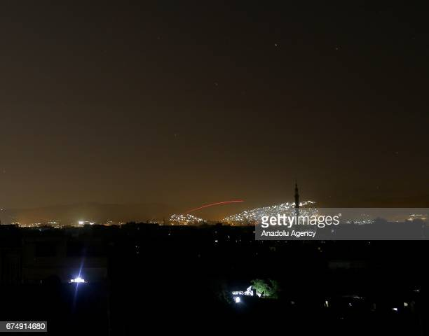 A night view shows explosions and bullet traces on the sky during clashes between Assad Regime and opposition forces arounf Jobar and Qaboun...