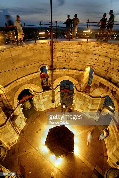 A night view shows the bells inside the top of the Leaning Tower of Pisa August 23 in Pisa Italy The tower reopened in December 2001 after 10 years...