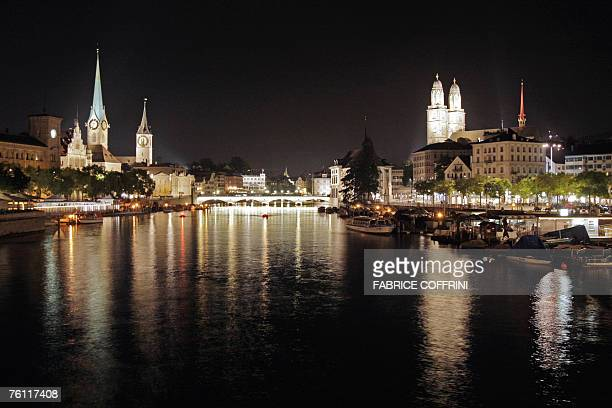A night view taken 14 August 2007 the old town of Zurich with the Grossmuenster church right and left of the Limmat river Zurich is the largest city...
