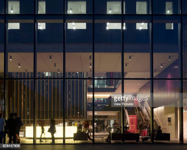 Night view through glazing into reception John Henry Brookes Building Oxford Brookes University Oxford United Kingdom Architect Design Engine...