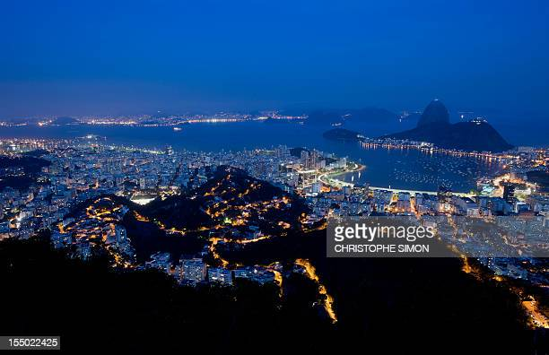 Night vue of the Guanabara bay with the Sugar Leaf in the background in Rio de Janeiro on October 30 Brazil AFP PHOTO / CHRISTOPHE SIMON