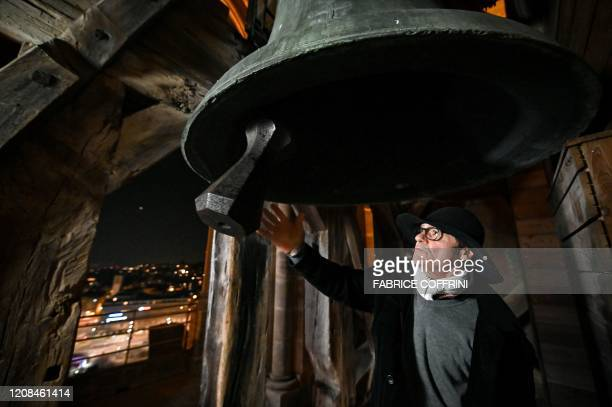 "Night watchman of the Cathedral of Lausanne, Renato Haeusler manually rings the 3600 kg ""La Clemence"" emergency bell in the Cathedral's belfry tower,..."
