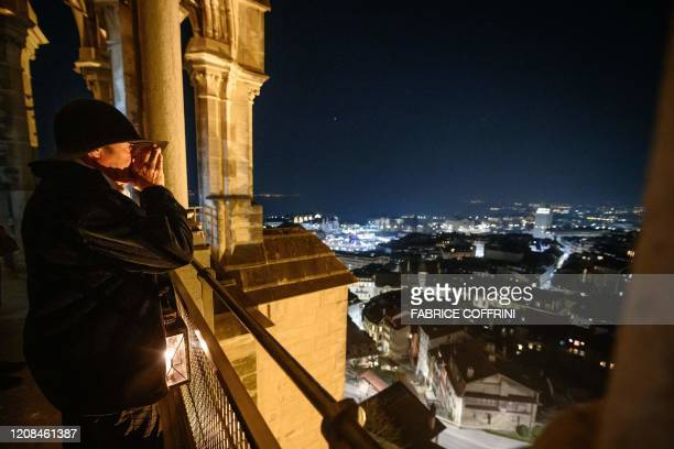"Night watchman of the Cathedral of Lausanne, Renato Haeusler shouts the hour prior to manually ringing the 3600 kg ""La Clemence"" emergency bell in..."