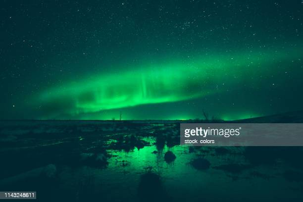 night winter landscape with aurora - north stock pictures, royalty-free photos & images