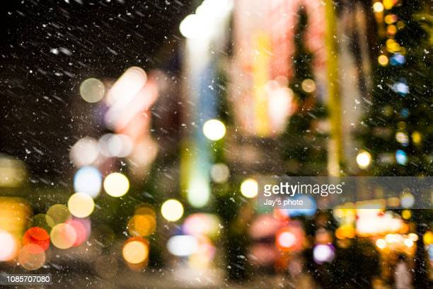 night with snow - new york city christmas stock photos and pictures