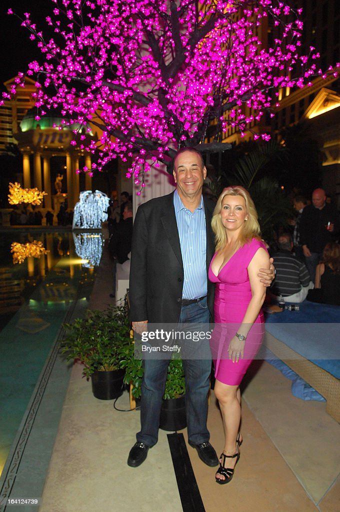 Nightclub & Bar Media Group President and host and Co-Executive Producer of the Spike television show 'Bar Rescue' Jon Taffer (L) and his wife Nicole Taffer appear during a welcome event to kick off the 28th annual Nightclub & Bar Convention and Trade Show at Caesars Palace on March 19, 2013 in Las Vegas, Nevada.