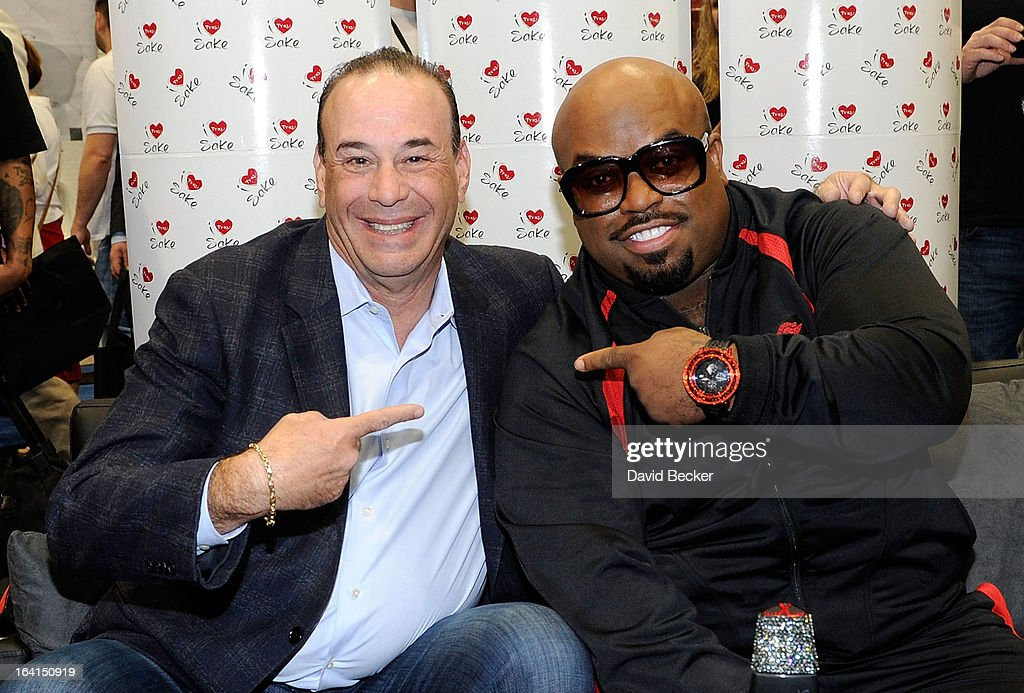 Nightclub & Bar Media Group President and host and Co-Executive Producer of the Spike television show 'Bar Rescue' Jon Taffer (L) and recording artist CeeLo Green pose at the Ty Ku Sake & Spirits booth during the 28th annual Nightclub & Bar Convention and Trade Show at the Las Vegas Convention Center on March 20th, 2013 in Las Vegas, Nevada.