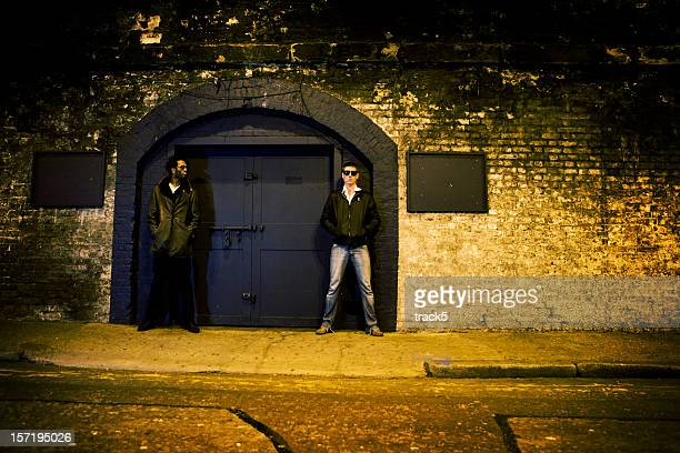 Nightclub bouncers standing outside an urban night club