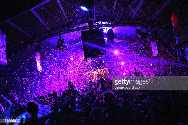 nightclub crowd cowered with confetti - entertainment club stock pictures, royalty-free photos & images