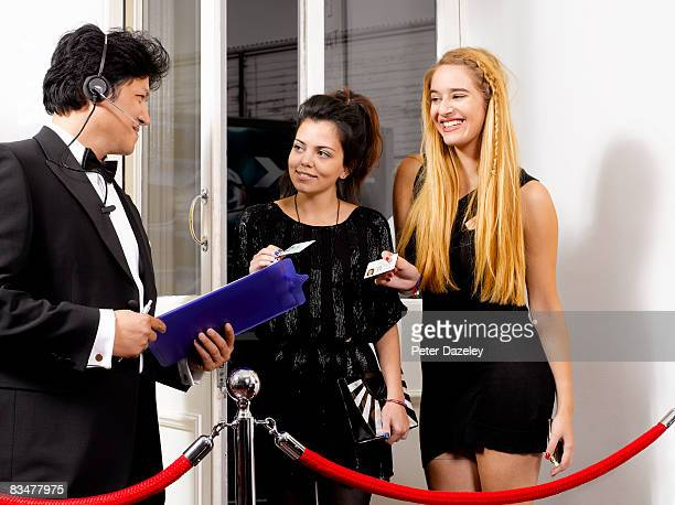 nightclub doorman checking id - bouncer security staff stock photos and pictures