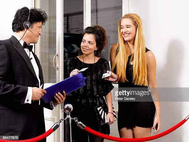 Nightclub doorman checking ID