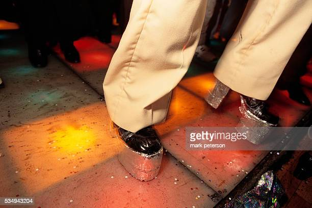 A nightclub goer wears platform shoes at the 20th anniversary celebration of the film Saturday Night Fever The disco scenes were filmed in this...