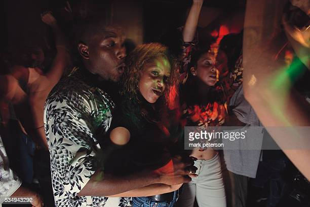 Nightclub goers dance at a club in South Beach in the Miami Beach area of Florida